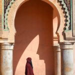 Woman in traditional dresses in Meknes, Bab Mansour, Morocco