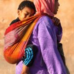 A woman carrying her child, Meknes, Africa