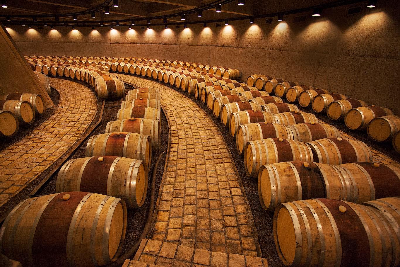 Oak barrels inside Bodega Zapata, Mendoza, Argentina
