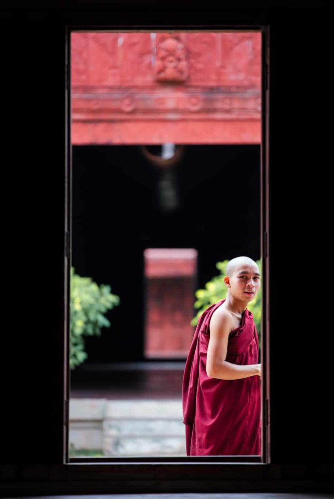 Novice monk inside the Mandalay Royal Palace, Burma