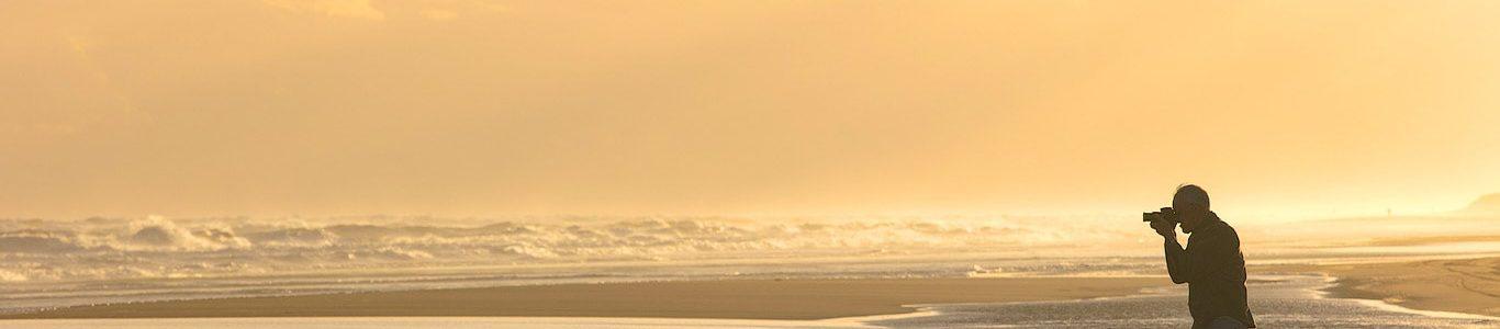 Photographer on the beach at sunset, Argentina