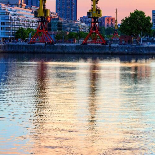 Couple on a boat at sunset in Puerto Madero